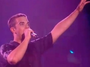 Robbie Williams sings Let Me Entertain You lyrics live